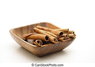 Cinnamon sticks  -  Cinnamon sticks in wooden bowl
