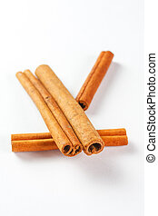 cinnamon sticks isolated on white background, close up