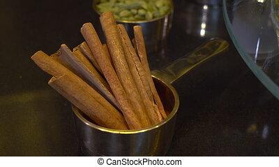 Cinnamon sticks on a display - A hand held, medium shot of a...