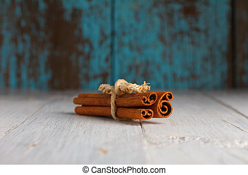 Cinnamon sticks on old wooden table still-life