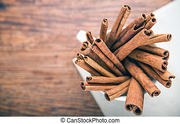 Cinnamon sticks on rustic paper close up with copy space