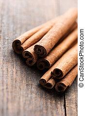 Cinnamon sticks on rustic wooden table
