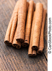 Cinnamon sticks on rustic wooden table close up