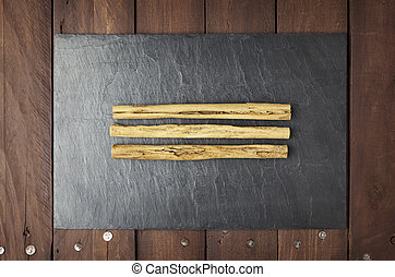 Cinnamon sticks on slate plate