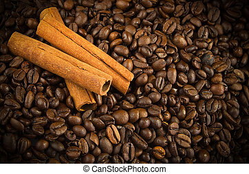 Cinnamon Sticks on the coffee beans background