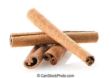 Cinnamon sticks on white reflective background.