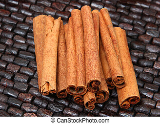 Cinnamon Sticks over Wooden Bead Table