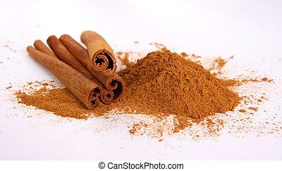 Cinnamon - three sticks and powder on white background.