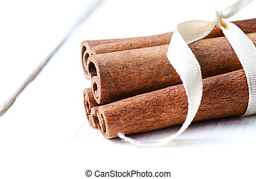 Cinnamon sticks tied up with ribbon