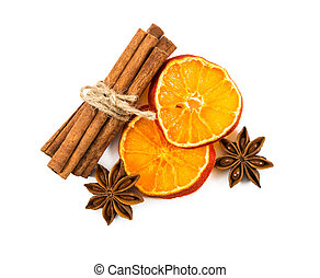 Cinnamon sticks tied with string, slices of dried orange and star anise
