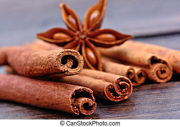 Cinnamon sticks with anise star on table