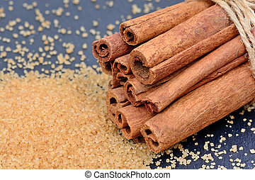 Cinnamon sticks with brown sugar on slate