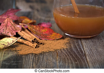 cinnamon sticks with cider and leaves