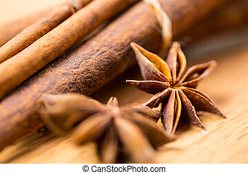 Cinnamon - Close up cinnamon anice stacked with white...