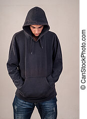 cinzento, parede, contra, baixo, adolescente, hoodie, olhar...