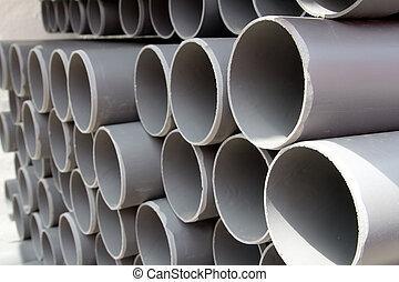 cinzento, pvc, tubos, plástico, canos, empilhado, em, filas