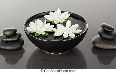 ciottoli, nero, chiudere, fiori, circondato, accatastare, su, galleggiante
