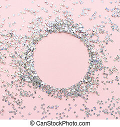 Circle border frame made of glitter on a pale pink pastel backgr