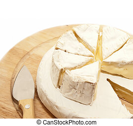 Circle brie and camembert cheese on wooden desk with knife