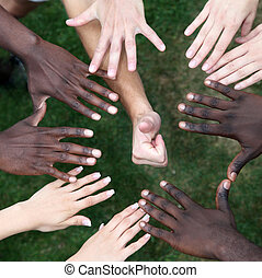 Circle of hands with young people from different nations -...