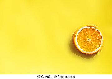 circle of orange on yellow background