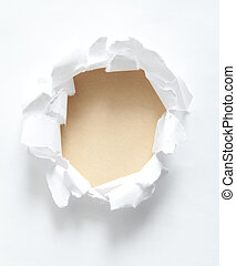 Circle ripped in white paper