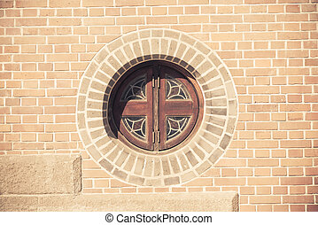 Circle window on the brick wall in vintage style