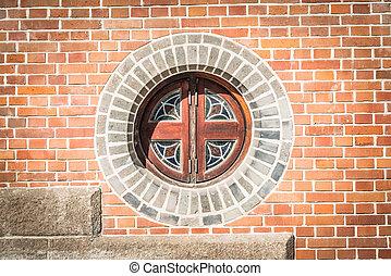 Circle window on the brick wall