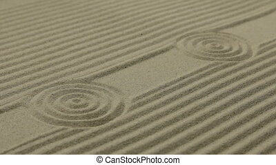 Circles and lines on the sand. Texture of sand. Slider shot...