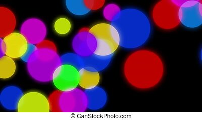 Circles background animation. Colorful circles slowly falling down on a dark background with particles flowing around