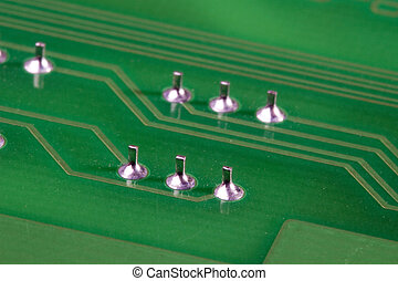 Circuit Board - Close-up photograph of a green circuit board...