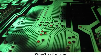 Circuit board electronics macro glowing in green light