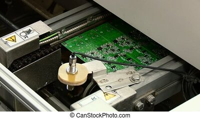 circuit board production line closeup - circuit board...