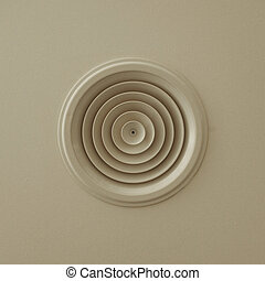 circular air vent on ceiling ventilation grille