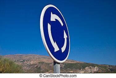 Circular crossroad sign