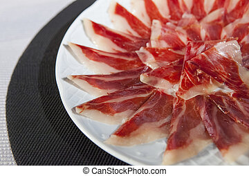 decorative arrangement of iberian cured ham on plate
