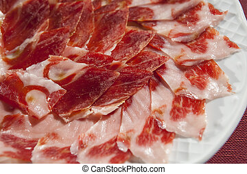 decorative arrangement of iberian cured ham on plate