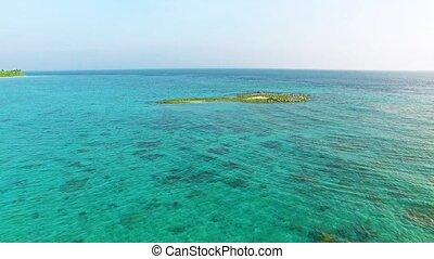 Circular flight over the edge of the shore on a tropical...