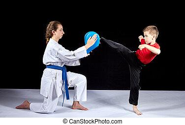 Circular kick kicking boy is beating on the simulator