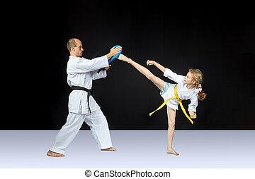 Circular kick kicking girl is beating on the simulator