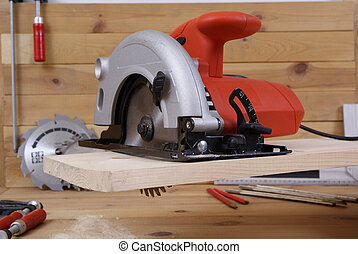 circular saw and accessories on the board