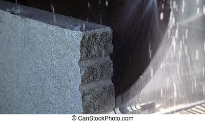 Cutting granite slab by a circular saw. - Circular saw...