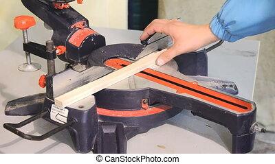 Circular saw for furniture manufacturing - Man using...
