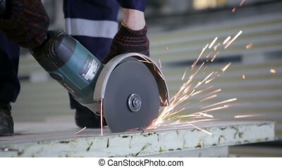 Circular saw in worker hands