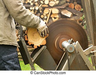 Working man with the circular saw.