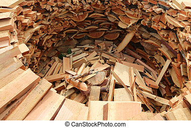 circular wood-burning lumber with many pieces of cut wood