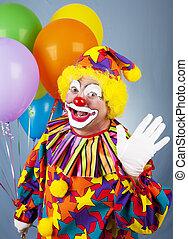 Circus Clown Waves Hello - Friendly circus clown holding a...