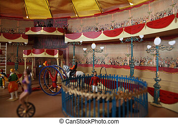 circus model with spectacors on balcone and many different artists on arena miniature