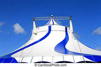 Circus tent - Exterior of circus tent with world flags, blue...