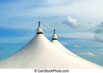 circus tent under blue sky